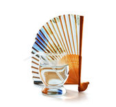 Glass of clean water and a fan — Stock Photo