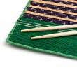 Chopsticks and bamboo plate - Stock Photo