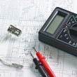 Digital multimeter and  lamp — Stock Photo