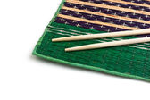 Chopsticks and bamboo plate — Stock Photo