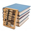 Wooden abacus on a pile of books — Foto Stock