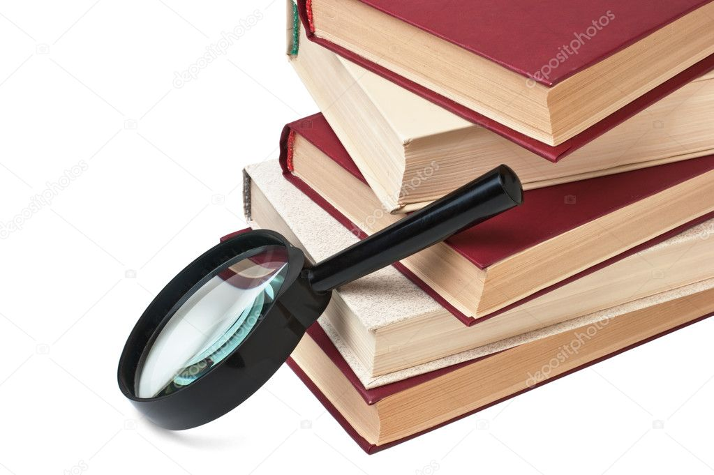 Stack of books and magnifying glass isolated on  white — Stock Photo #2067783