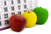 Apple on background of a calendar — Stock Photo