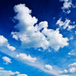 Stock Photo: Beautiful blue sky with cumulus clouds