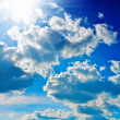 Blue sky with sun closely - Stock Photo