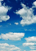 Blue sky with sparse clouds — Stock Photo
