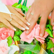 Hand on wedding bouquet — Stock Photo