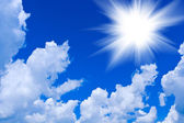 Cumulus clouds with sun — Stock Photo