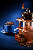 Composition of grinder and cup — Stock Photo