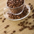 Transparent cup with coffee grains — Stock Photo