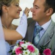 The bride looks after the groom — Stock Photo