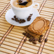 Stock Photo: Cup of capuchino with coffee beans