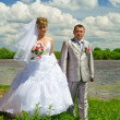 Wedding pair on coast of the river — Stock Photo #2305713