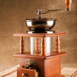 Coffee mill with coffee beans — Stock Photo #2400687