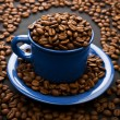 Composition of coffee grains and cup - Stock Photo