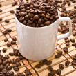 Composition of coffee mug and grain - Stock Photo