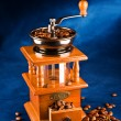 Manual coffee grinder with grains - Stock Photo