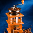 Manual coffee grinder with grains — Stockfoto