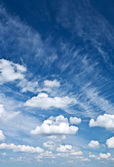 Cumulus and cirrus clouds — Stock Photo