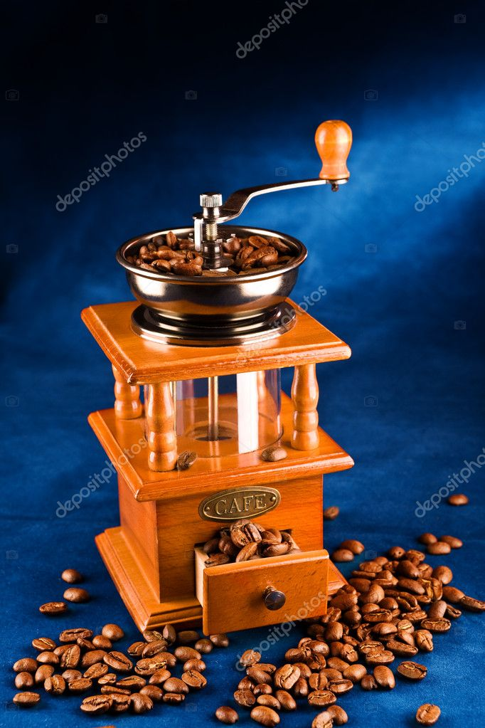 Manual coffee grinder with grains of coffee on a dark blue background  Stock Photo #2464852