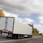 White truckson highway — Stock Photo