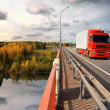 Sunset trucking, bridge - Stock Photo
