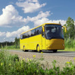 Stock Photo: Yellow tourist bus on highway