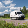 White van on rural highway - Stock Photo