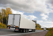 White truckson highway — Stock Photo