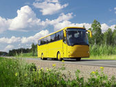 Yellow tourist bus on highway — Стоковое фото