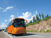 Orange bus on highway — Stock Photo
