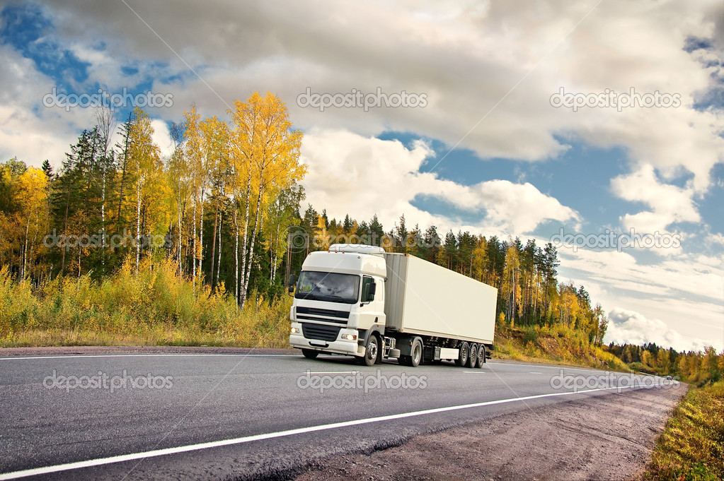 White truck on autumn highway — Stock Photo #1007464