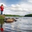 Stock Photo: Little angler on lake