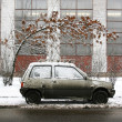 Car in dirty winter - Stock Photo
