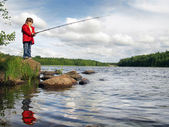 Little angler on the lake — Stock Photo