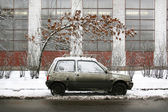 Car in dirty winter — Stock Photo