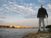 Sunset of old man — Stock Photo