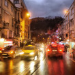 Night traffic in rainy city - Stock Photo