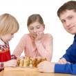 Royalty-Free Stock Photo: Man and childs play to chess