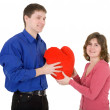 Man give heart to the woman - Stock Photo