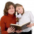 Woman with girl reading book - Lizenzfreies Foto
