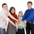 Family and terrestrial globe — Stock Photo