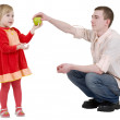 Stock Photo: Man give apple to the girl