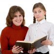 Stock Photo: Woman with girl reading book