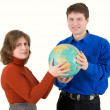 Man and woman hold globe — Stock Photo