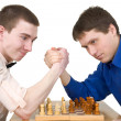 Wrestling mans and chess — Stock Photo