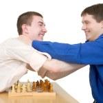 Wrestling boys ang chess — Stock Photo