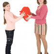 Woman give heart to girl - Stock Photo