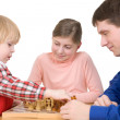 Royalty-Free Stock Photo: Man and children play chess