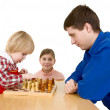 Man and childs play chess - Stock Photo